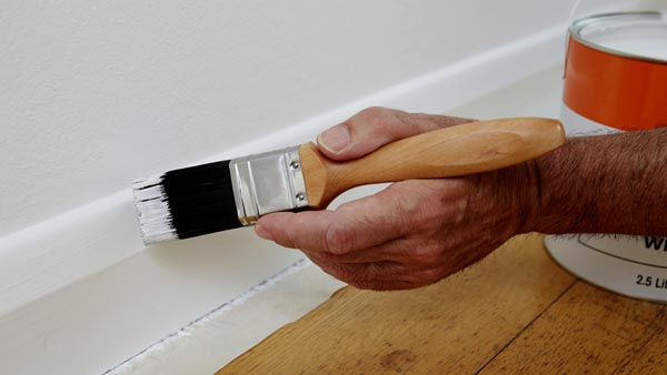 Painting Skirting Boards Using Tape To Protect Floor