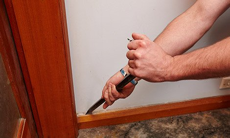Removing Skirting Board Using A Crowbar