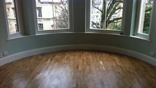 A Skirting Board Fitted Around The Inside Of A Bay Window Area