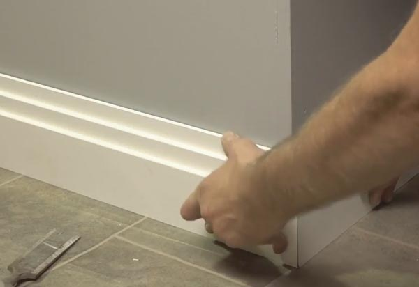 Use Pressure To Push The Skirting Board Into Position On The Wall