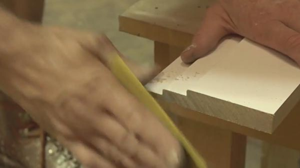 Use Sandpaper To Take Off The Burr On The End Of The Skirting Board