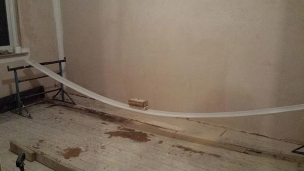 Using Weight To Gradually Bend The Skirting Board Into Shape